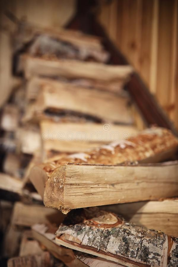 Wood burning stove. Firewood for furnace heating. Warehouse for stock photos