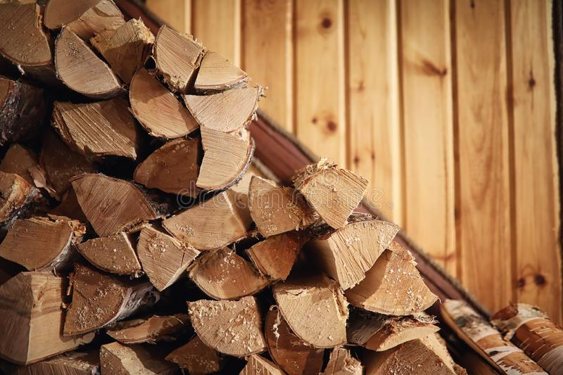 Wood burning stove. Firewood for furnace heating. Warehouse for royalty free stock photography