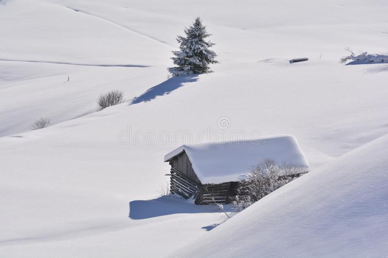 Wood cabin in deep snow stock images