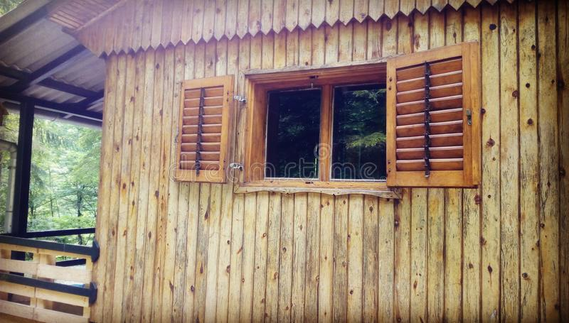 Wood cabin in forest stock photography
