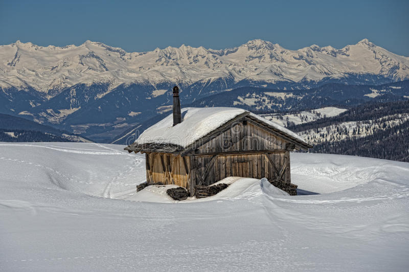 A Wood Cabin Hut In The Winter Snow Background Stock Image