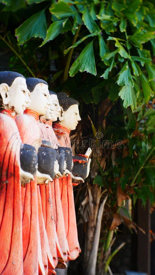 Wood Carved Buddha, old Myanmar temple and Buddha outdoor garden royalty free stock photos