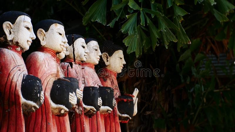 Wood Carved Buddha, old Myanmar temple and Buddha outdoor garden stock image