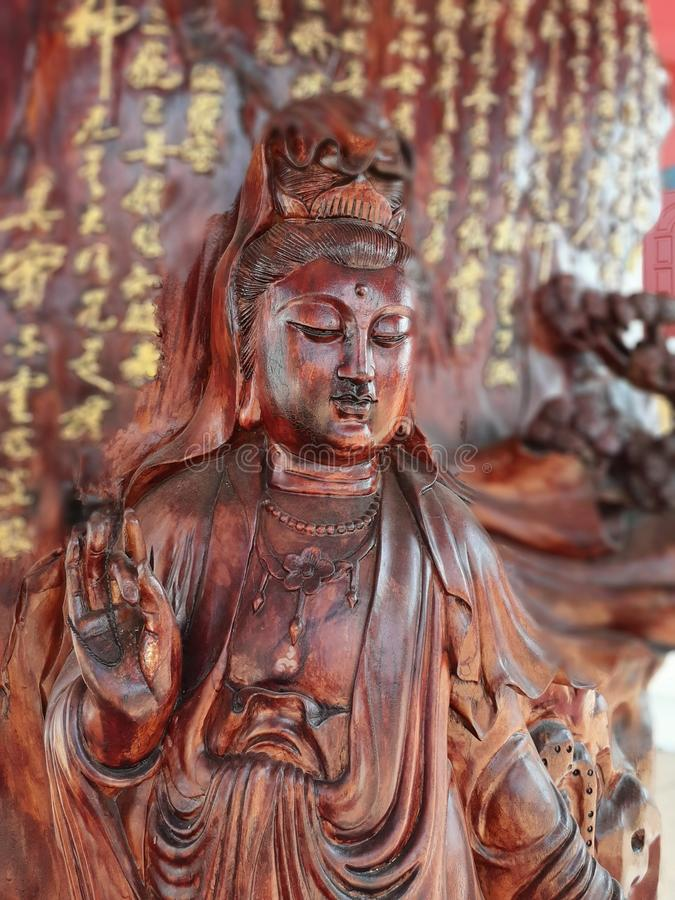 Wood carving. Buddhas measure priest monk statue respect guanimfallout royalty free stock photo