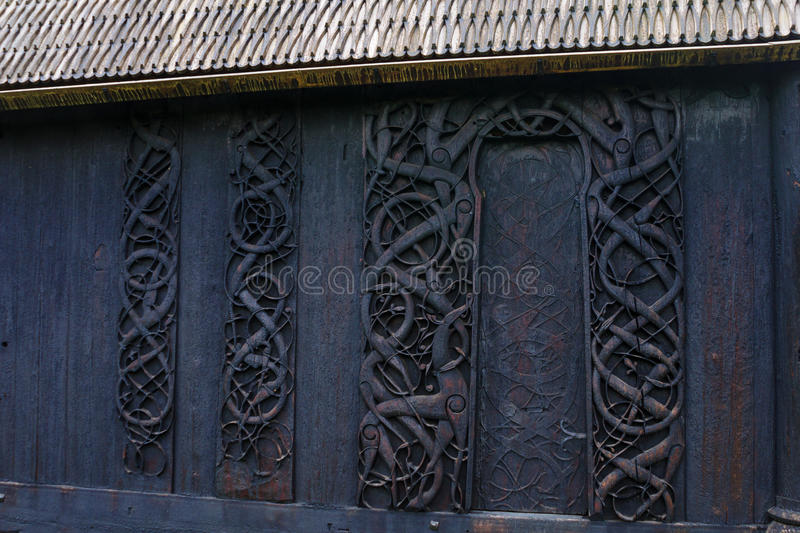 Wood carving in the old church of Urnes stock photos