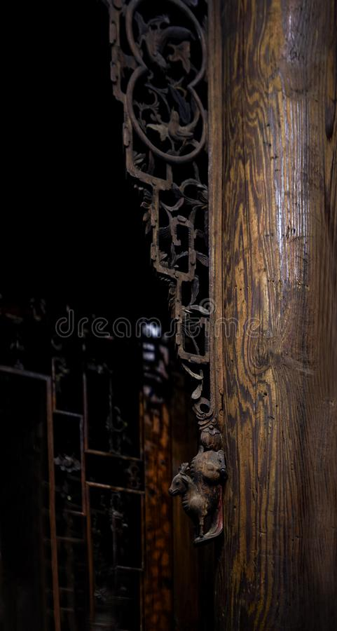 Wood carving pattern on the load-bearing wooden pillar of Chinese ancient building stock image