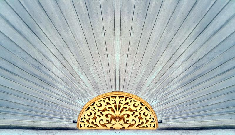 Wood carving pattern over the door of Chinese style house stock image