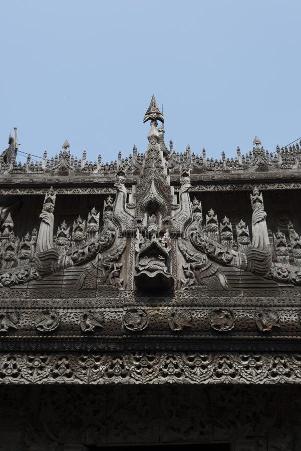 Wood carving on Shwenandaw monastery, Mandalay, Myanmar. Shwenandaw Monastery is the only original building from Mandalay Palace that survived the bomb during stock image