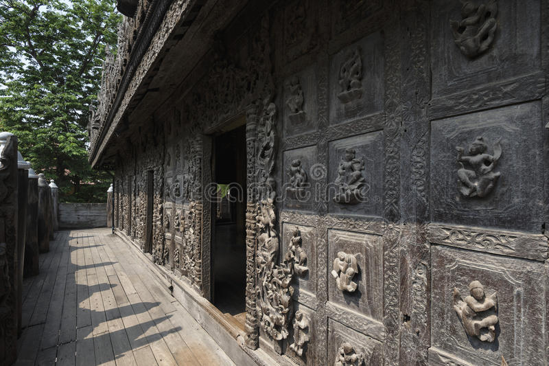 Wood carving on Shwenandaw monastery, Mandalay, Myanmar. Shwenandaw Monastery is the only original building from Mandalay Palace that survived the bomb during royalty free stock image