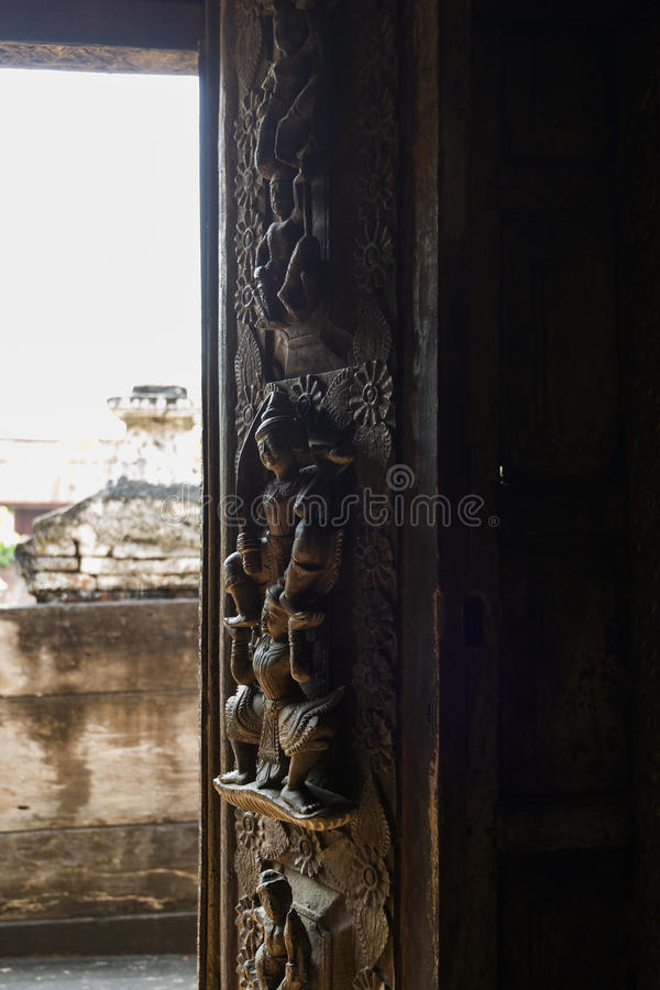 Wood carving on Shwenandaw monastery, Mandalay, Myanmar. Shwenandaw Monastery is the only original building from Mandalay Palace that survived the bomb during royalty free stock photos