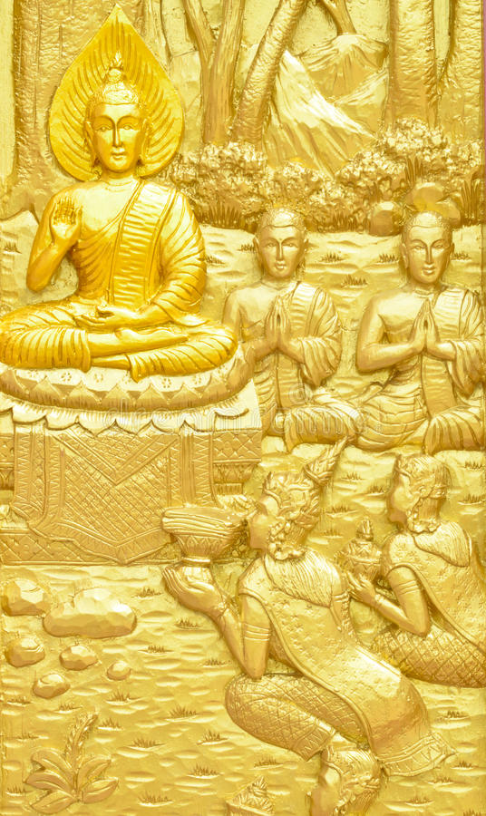 Wood carving about Thai Buddha story at Thai temple door. Public places of Buddhist worship stock photo