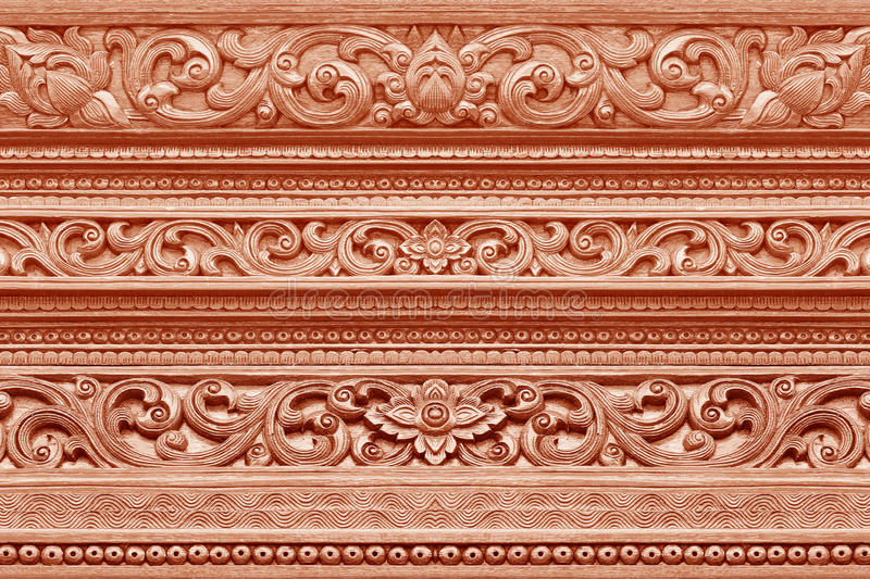 Wood carvings on the wall temple. In chaing mai Thailand; thai art style stock photo