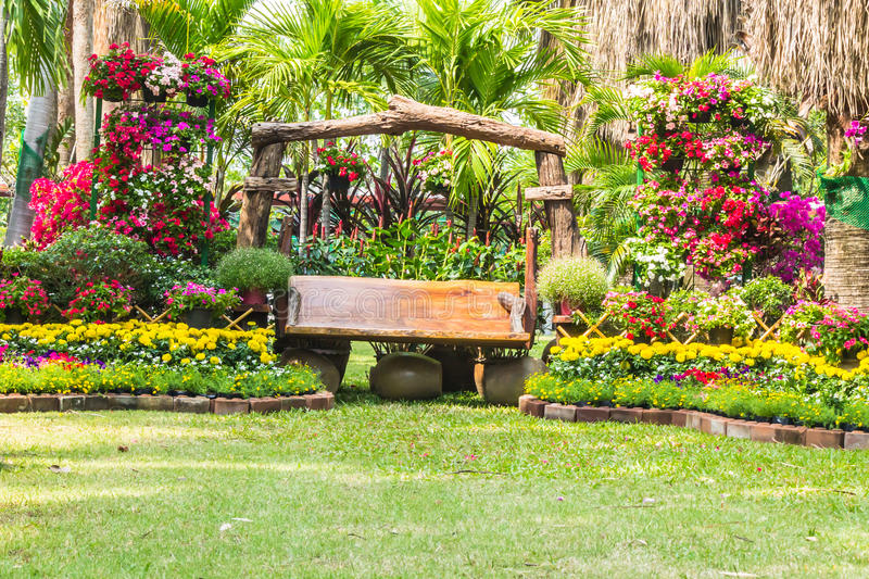 Wood chair in the flowers garden. Wood chair in the flowers garden on sunyday stock images
