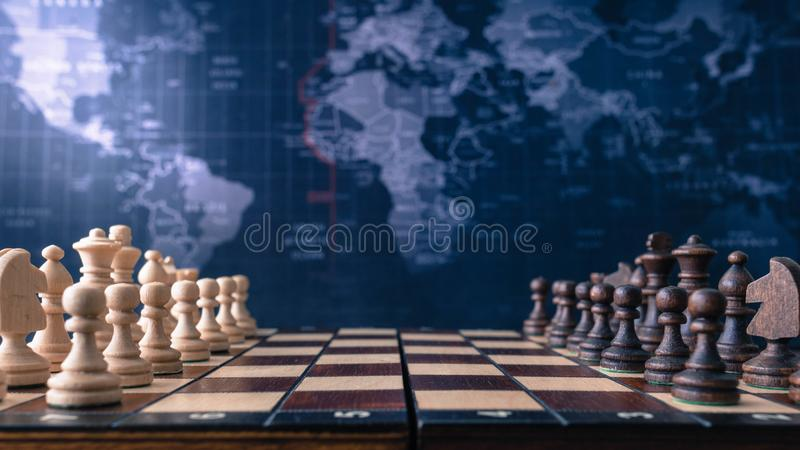 Wood chessboard with wood pieces royalty free stock photography