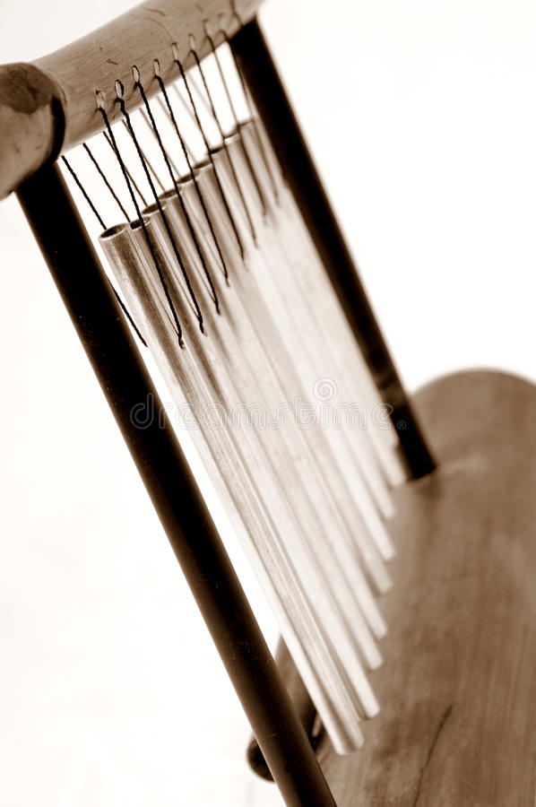 Wood Chime. Close-up of a set of chimes in sepia tone stock image