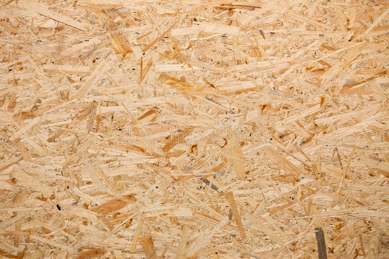 Wood chipboard, texture. Yellow wood chipboard can be used as a background royalty free stock photography