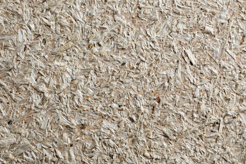 Wood chippings board as textured background. Wood board made from piece of wood.Texture of oriented strand board OSB royalty free stock images