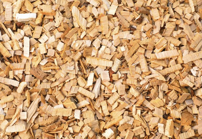 Wood chips of alder-tree for smoking or recycle. Texture for background. Yellow and red wood chips of alder-tree for smoking or recycle. Texture for background stock image