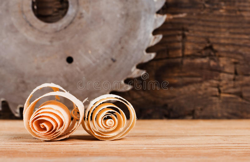 Wood chips and disk circular saw. Working with wood products stock image