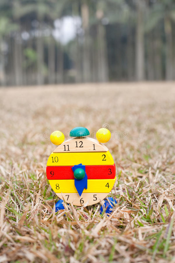 Download Wood clock on grass stock image. Image of block, grass - 22737985
