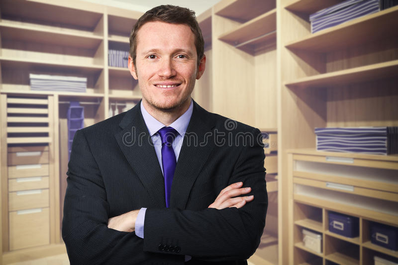 Wood closet and man. Classic wood modern closet background and man portrait stock photography