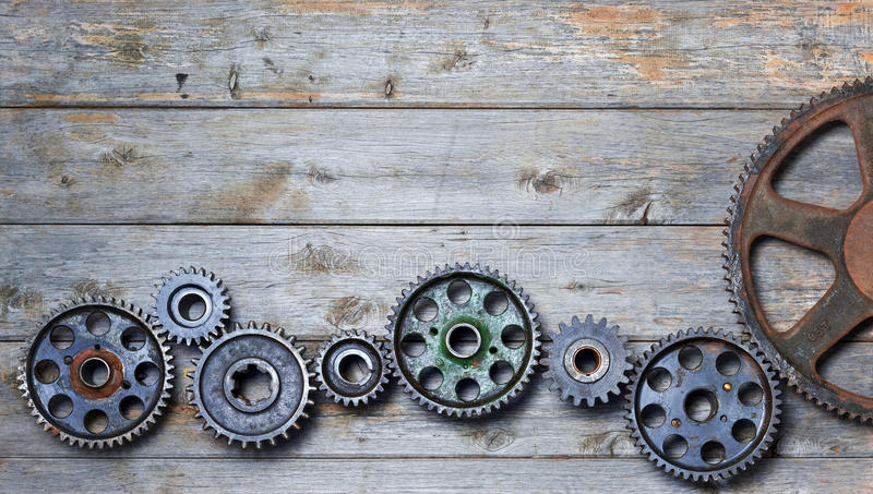 Wood Cogs Technology Industry Business Background. Old cogs on a worn wood background stock photo