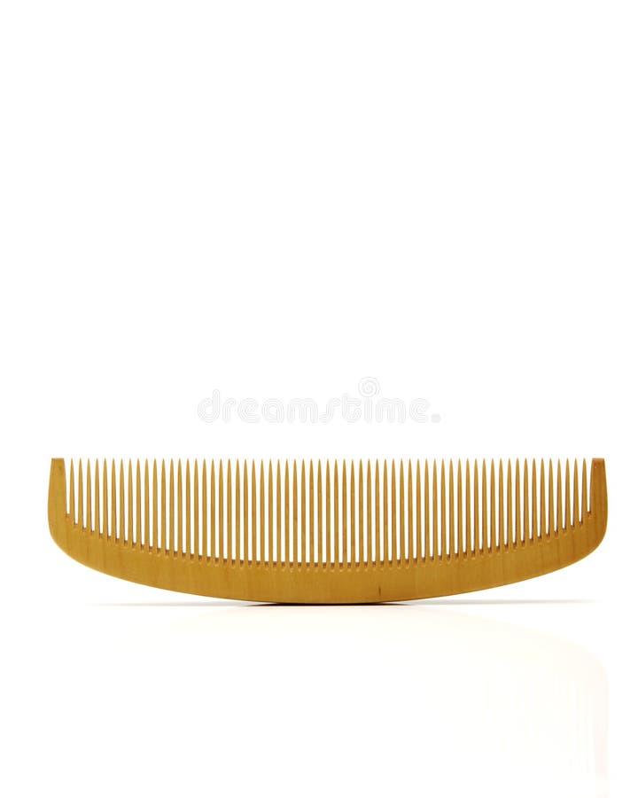Wood comb sign barbershop. Symbol of hair and beauty salon stock photos