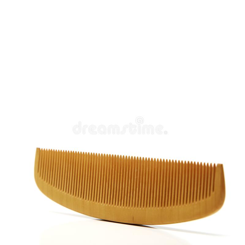 Wood comb sign barbershop. Symbol of hair and beauty salon stock photo