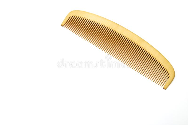 Wood comb sign barbershop. Symbol of hair and beauty salon royalty free stock images