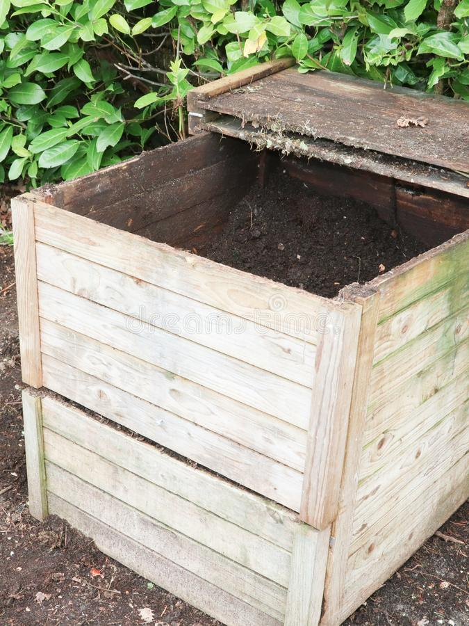 Wood Compost bin in the grass royalty free stock images