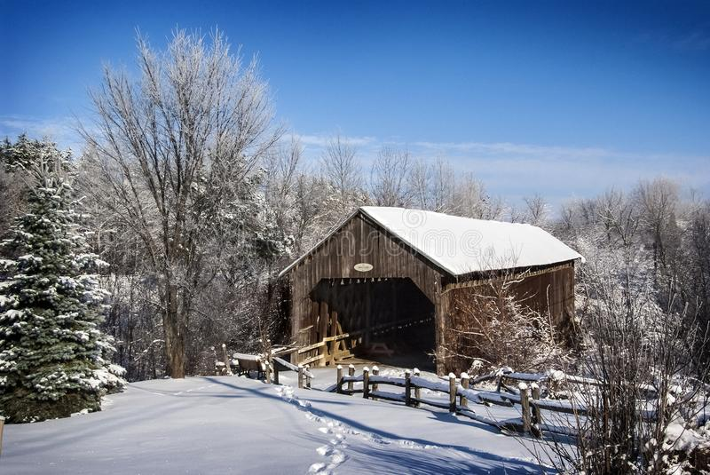 Wood covered bridge in Cookshire eaton during a cold winter day in Canada royalty free stock photo