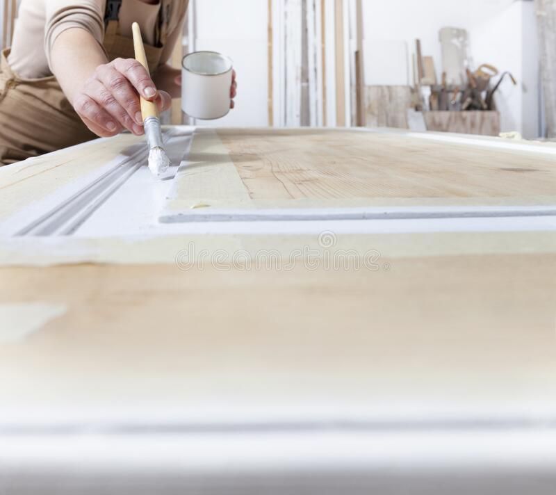 Free Wood Crafts, Close Up Hands Woman Artisan Carpenter Painting With Brush And Paint Jar White The Door In Workshop, Wearing Overall Stock Photo - 210592170