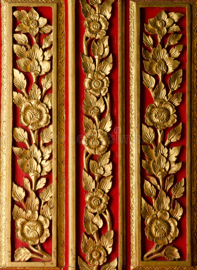 Wood crave pattern on the door in the temple. Wood crave pattern on the door at the temple royalty free stock photography
