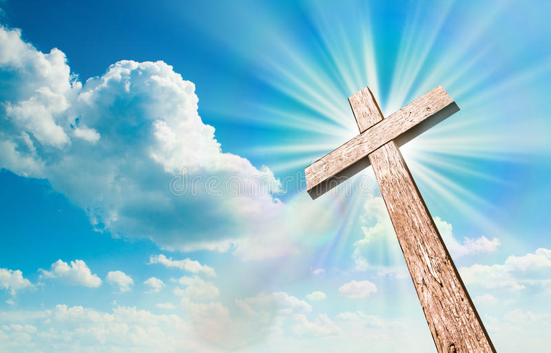 Wood cross on blue sky stock images