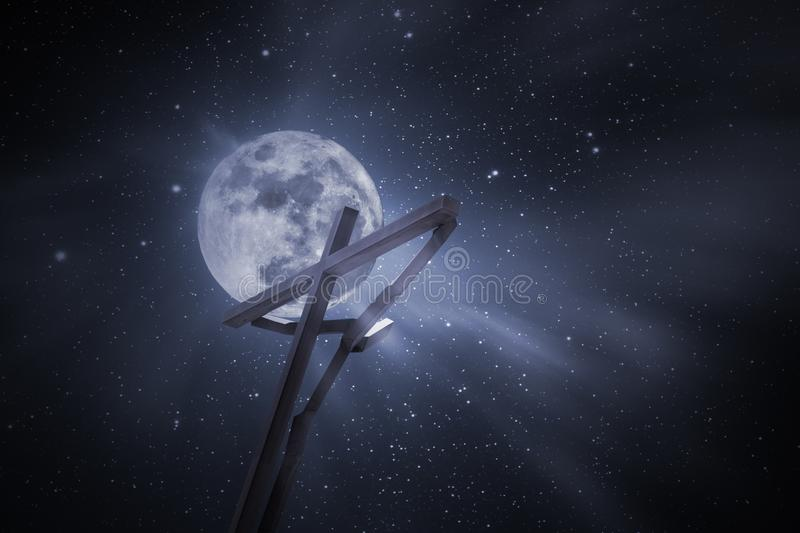 Wood cross in a full moon night royalty free stock image