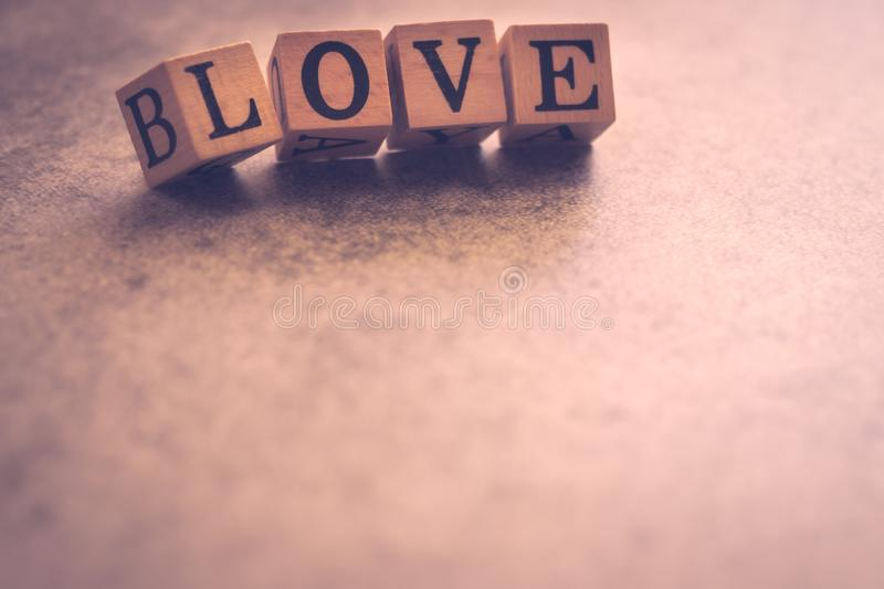 Wood cube letter word of LOVE with copy space. Concept for lovely story or message or quote. Be my romantic Valentine. Love. Background conceptual image stock photo