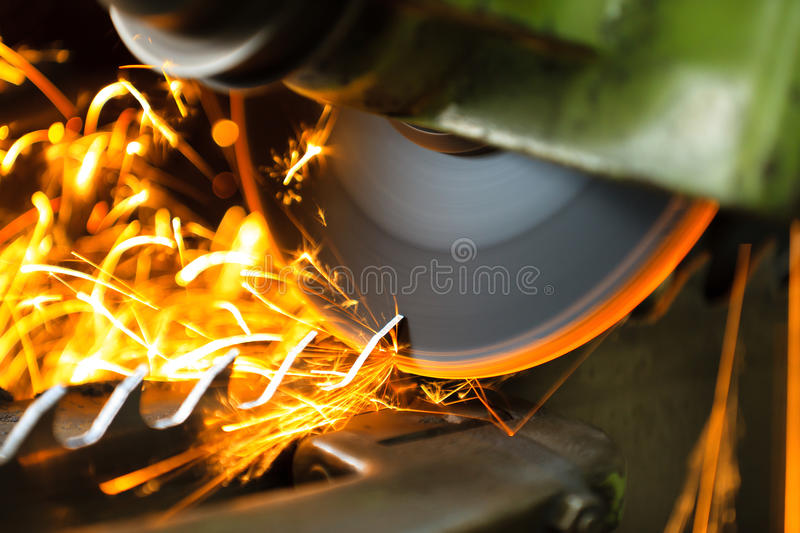 Wood cutting machine during the blade sharpening with a lot of sparks royalty free stock image