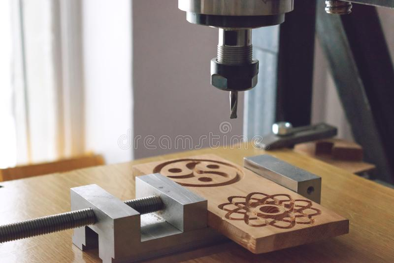 wood cutting machine 3D wood cnc router. CNC milling machine carving a wooden part blank. Cutter controlled by computer while he royalty free stock images