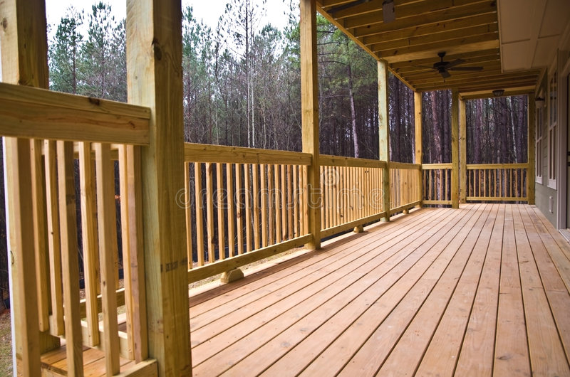 Wood Deck/Porch on House. A wood deck running along the back of a house stock images
