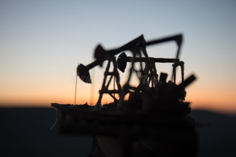 Wood Decoration. Oil pump oil rig energy industrial machine for petroleum in the sunset background for design. Selective focus stock images