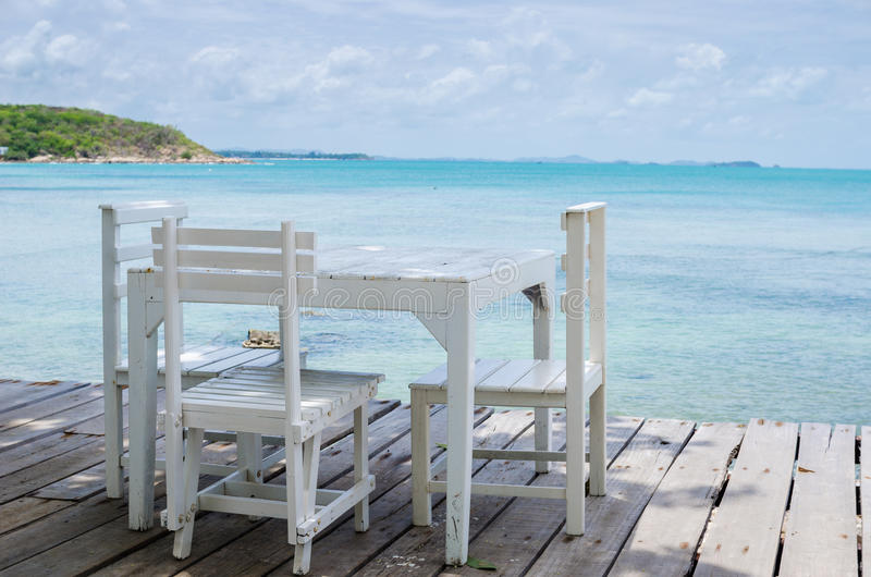 Wood dock White chair and table. In Koh Samet Thailand royalty free stock images