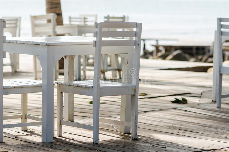 Wood dock White chair and table. In Koh Samet Thailand royalty free stock photography