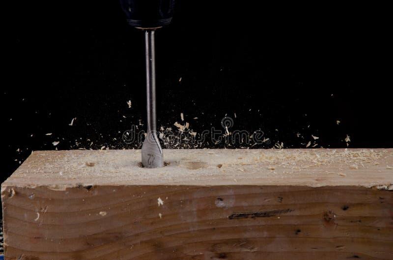 Wood drill bit. Closeup view of rotating wood drill bit royalty free stock image