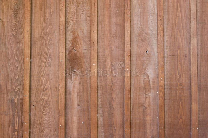 Wood Fence. A traditional wood fence shot of vertical wood planks stock image