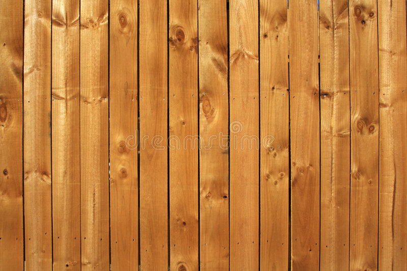 Wood fence. Natural yellow wood boards pattern stock photos