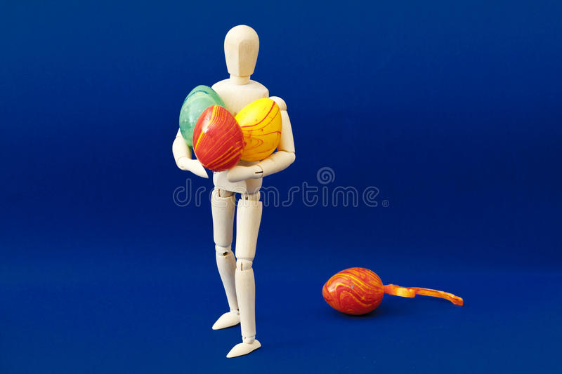Download Wood Figure With Easter Eggs Stock Photo - Image of figurine, blue: 19758830