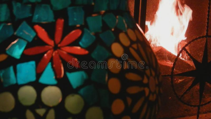 Wood fire burning, snap, stained glass candleholder, metal screen, Broadview, Seattle, Washington, USA royalty free stock photo