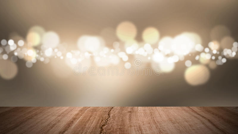 Wood floor and bokeh gold background. stock photos