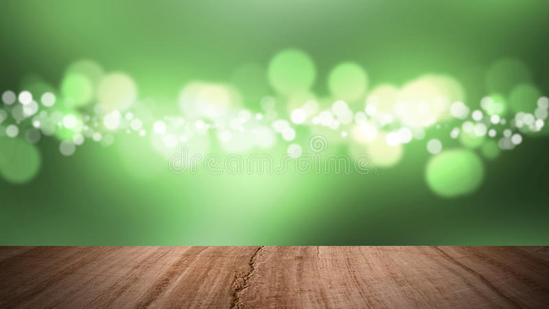 Wood floor and bokeh green background. stock photography