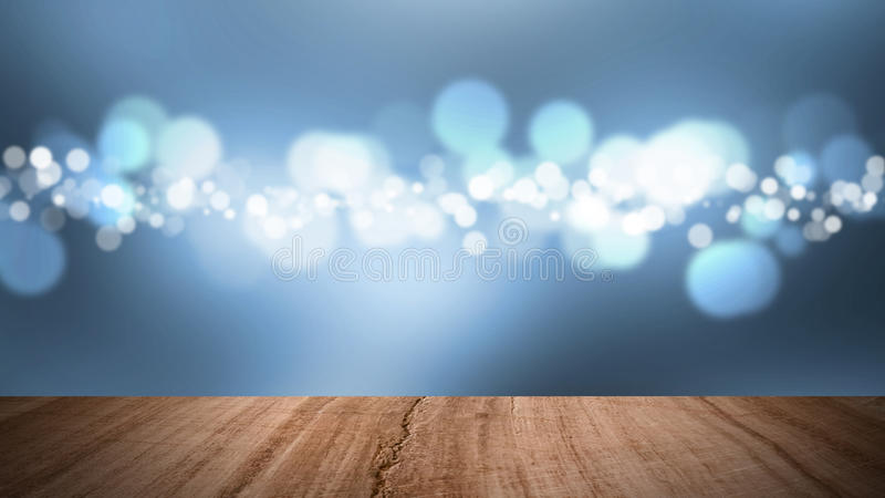 Wood floor and bokeh light blue background. royalty free stock photo